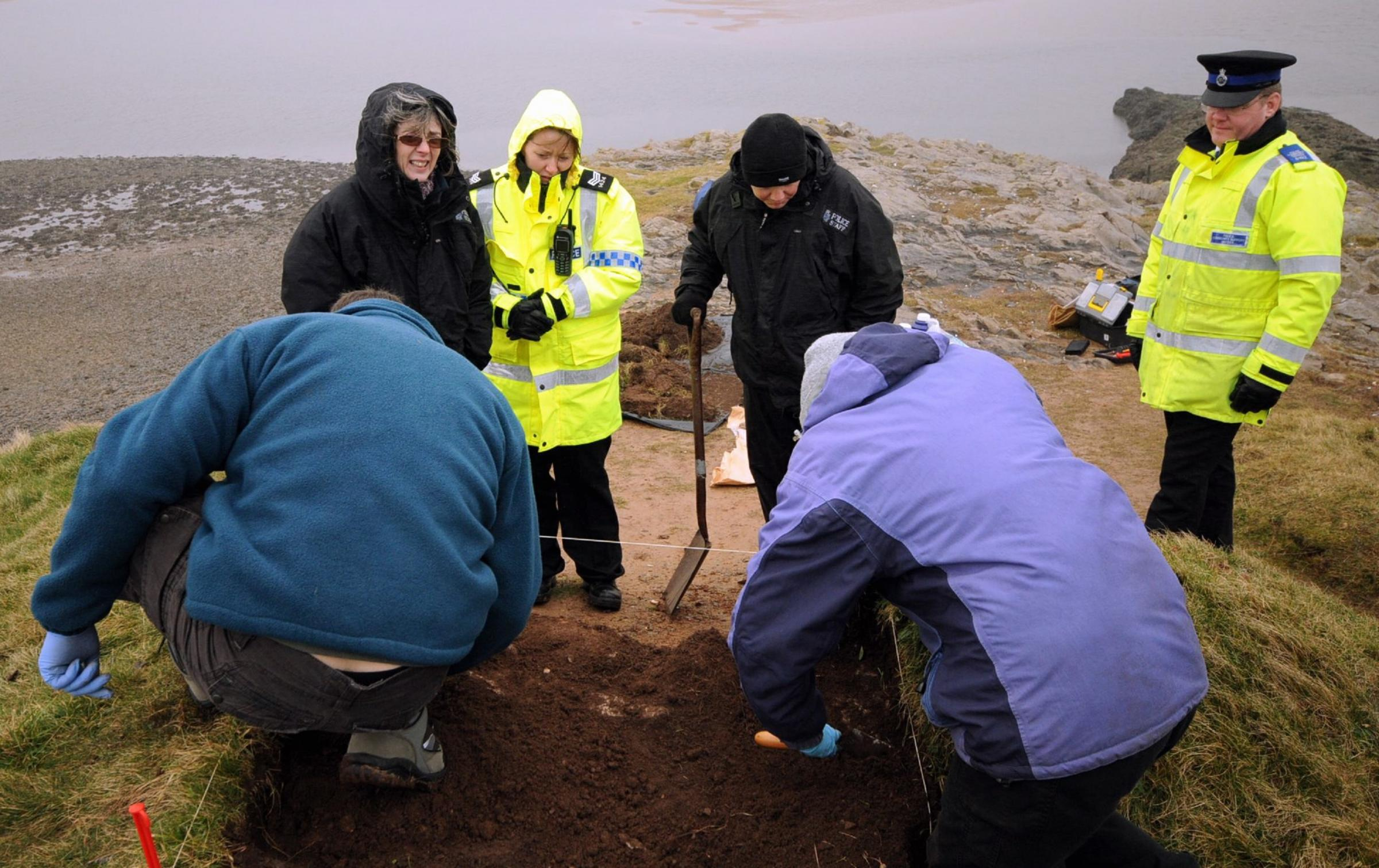 Discovery: Archaeologists and police at Hodbarrow Point, Millom, in 2009, after ancient human bones were found